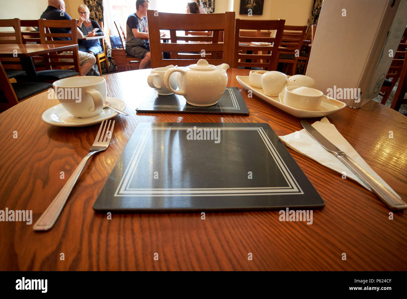 place setting in an old fashioned cafe tea room Keswick Lake District Cumbria England UK - Stock Image