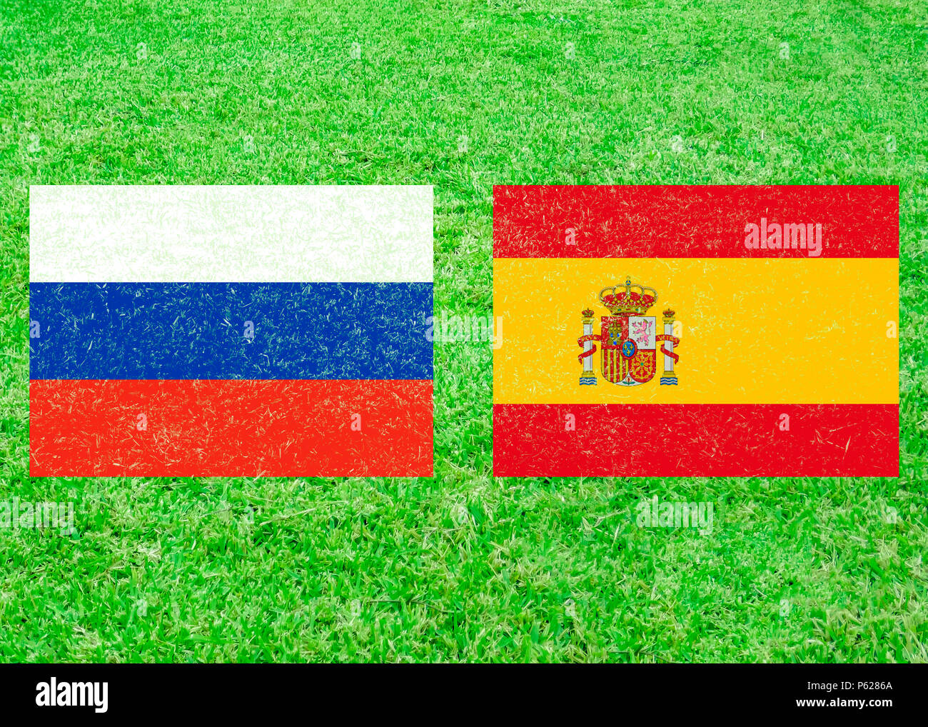 russia versus spain flags icon over grass background stock photo