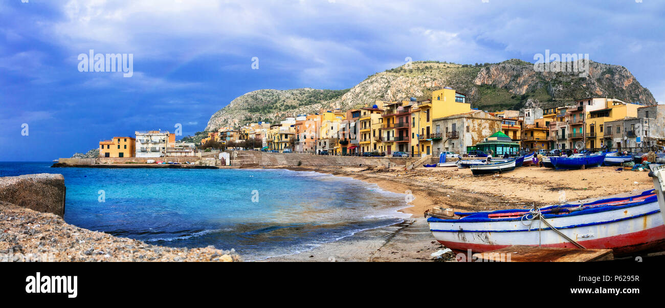 Traditional fishing boats and colorful houses in Aspra village,Bagheria,Sicily,Italy. - Stock Image
