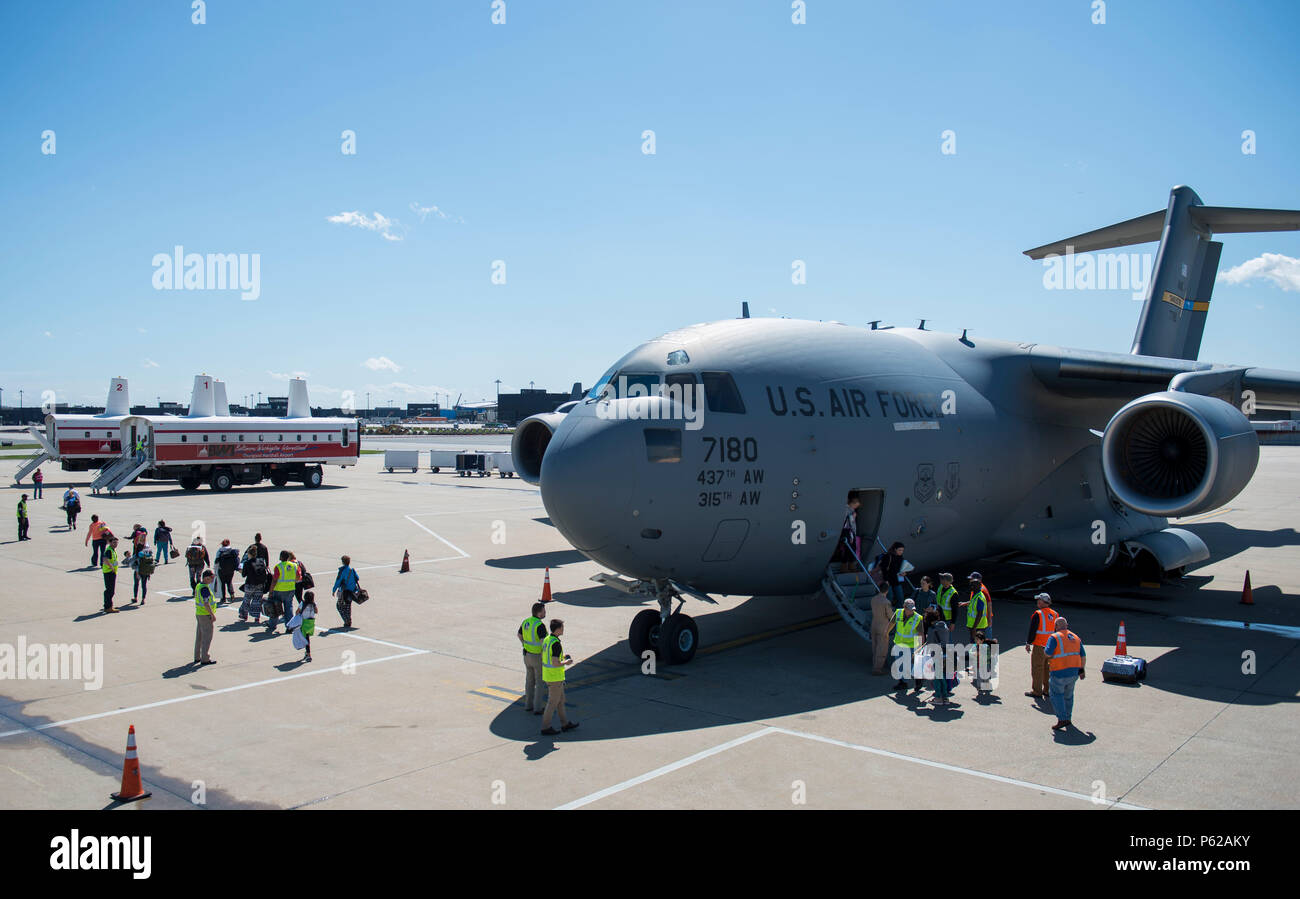 Dependents of military members from Incirlik Air Base, Turkey, disembark from a C-17 Globemaster III after landing at Baltimore Washington International Airport, Md., April 1, 2016. Defense Department dependents in Adana, Izmir and Mugla, Turkey, were given an ordered departure by the State Department and Secretary of Defense. The aircraft is assigned to the 437th Airlift Wing at Joint Base Charleston, S.C. (U.S. Air Force photo/Staff Sgt. Andrew Lee) - Stock Image