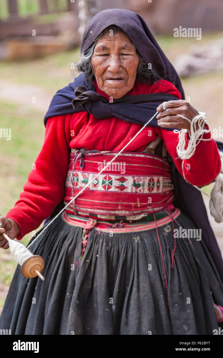 The island of Taquile located in Lake Titicaca on the Peruvian High Andean Plateau, is known for its textile art. - Stock Image