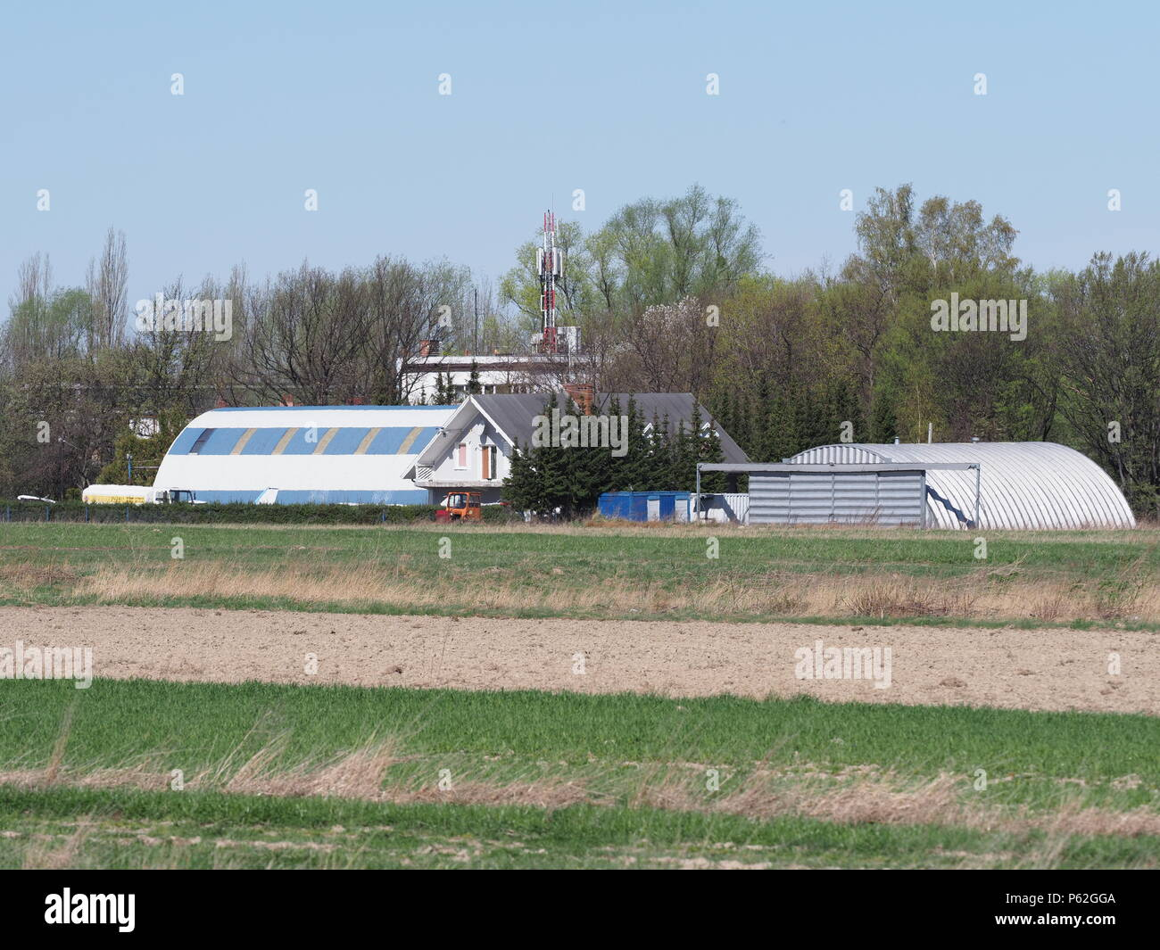 Buildings of local sport airport on grassy field landscape in european Bielsko-Biala city at Poland - Stock Image