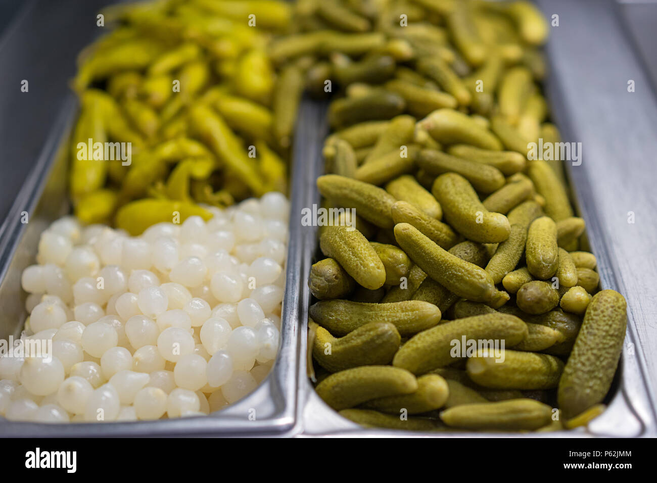 Pickles as background. Green pickle texture pattern. pickled cucumber, - Stock Image