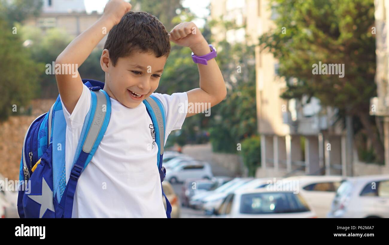 Feeling strong on the first day of school Stock Photo
