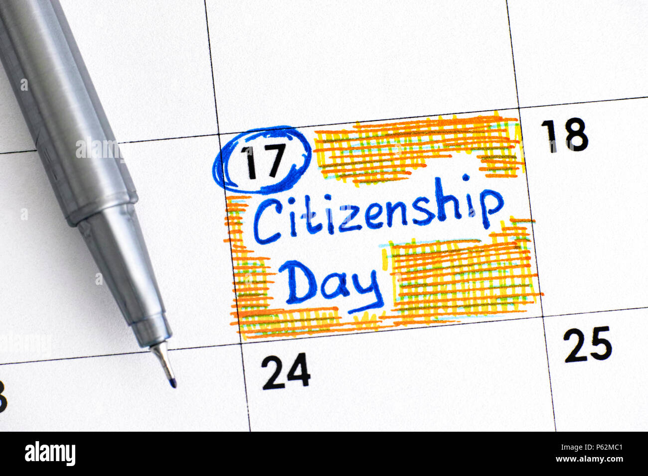 Reminder Citizenship Day in calendar with pen. Close-up. - Stock Image