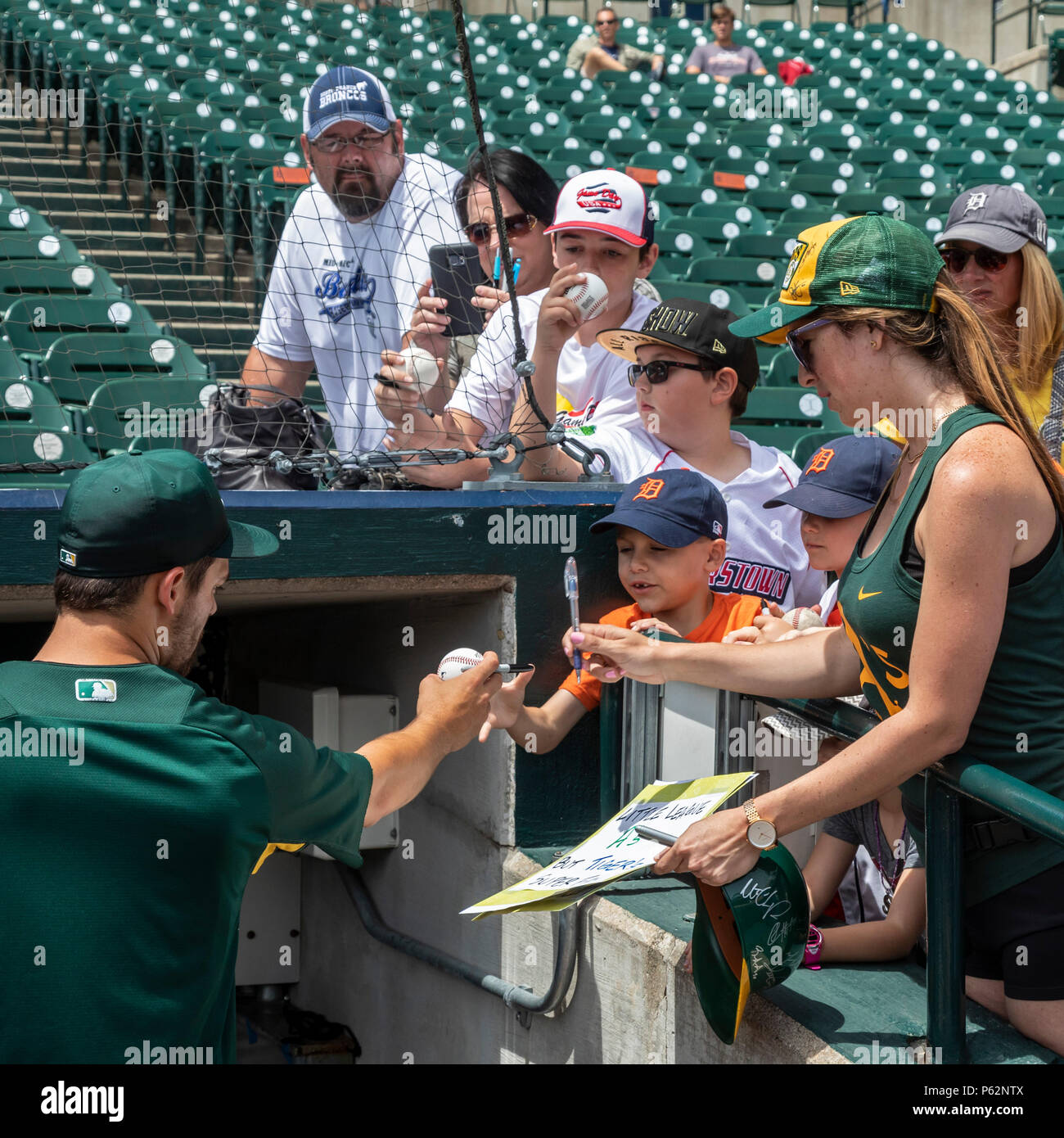 Detroit, Michigan - Chad Pinder, a utility player for the Oakland Athletics, signs autographs before a game against the Detroit Tigers at Comerica Par - Stock Image