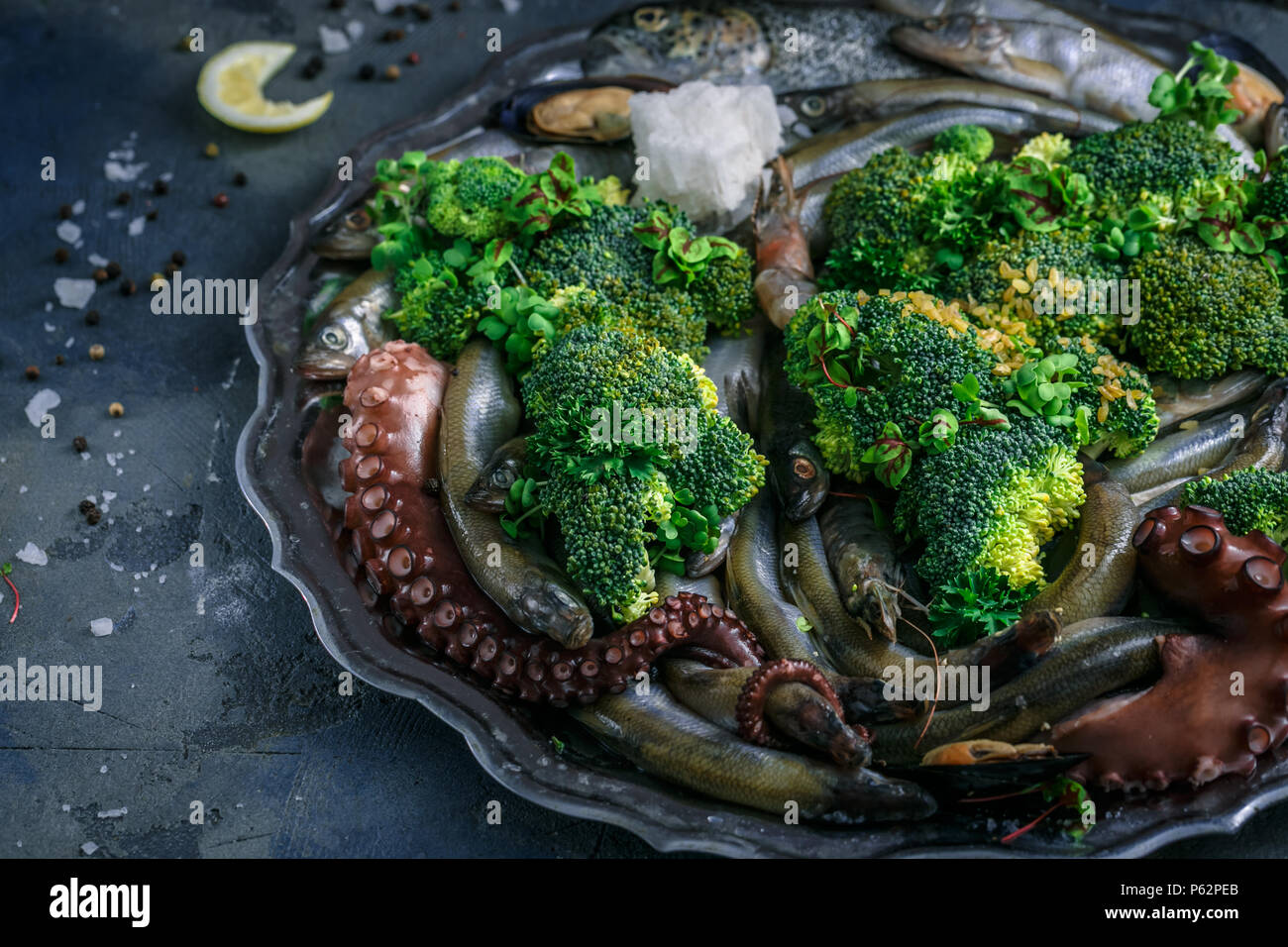 Close view of Raw Mixed seafood with vegs - Stock Image