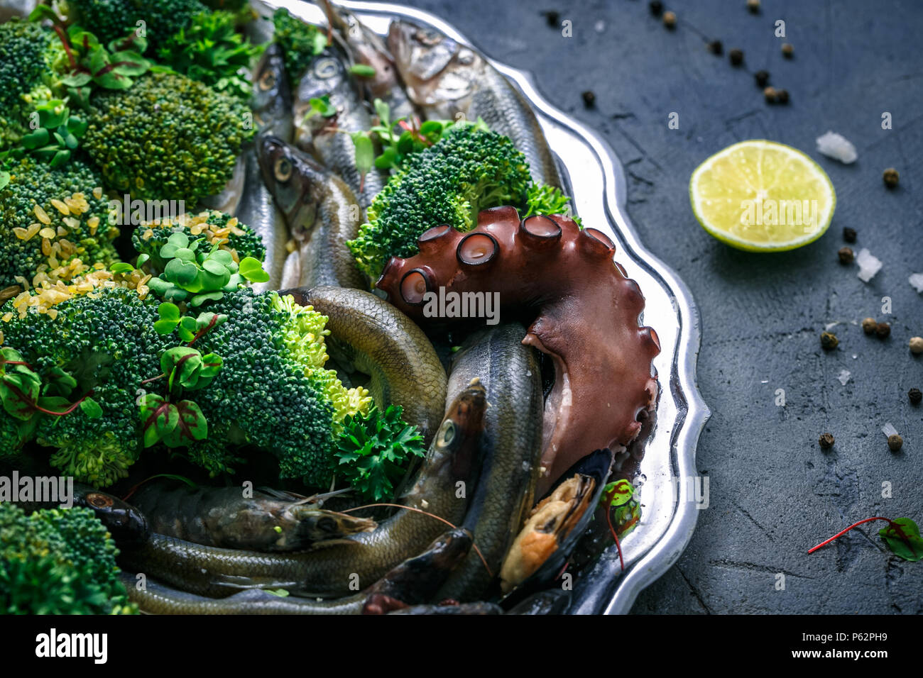 Close view of fresh seafood. Fish, shrimp, octopus and mussels. - Stock Image