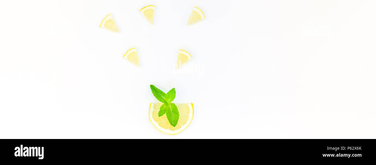 Long wide banner top view citrus lemon slices and mint herbs leaves white table background with copyspace. Hot summer refreshment lemonade concept. Be - Stock Image