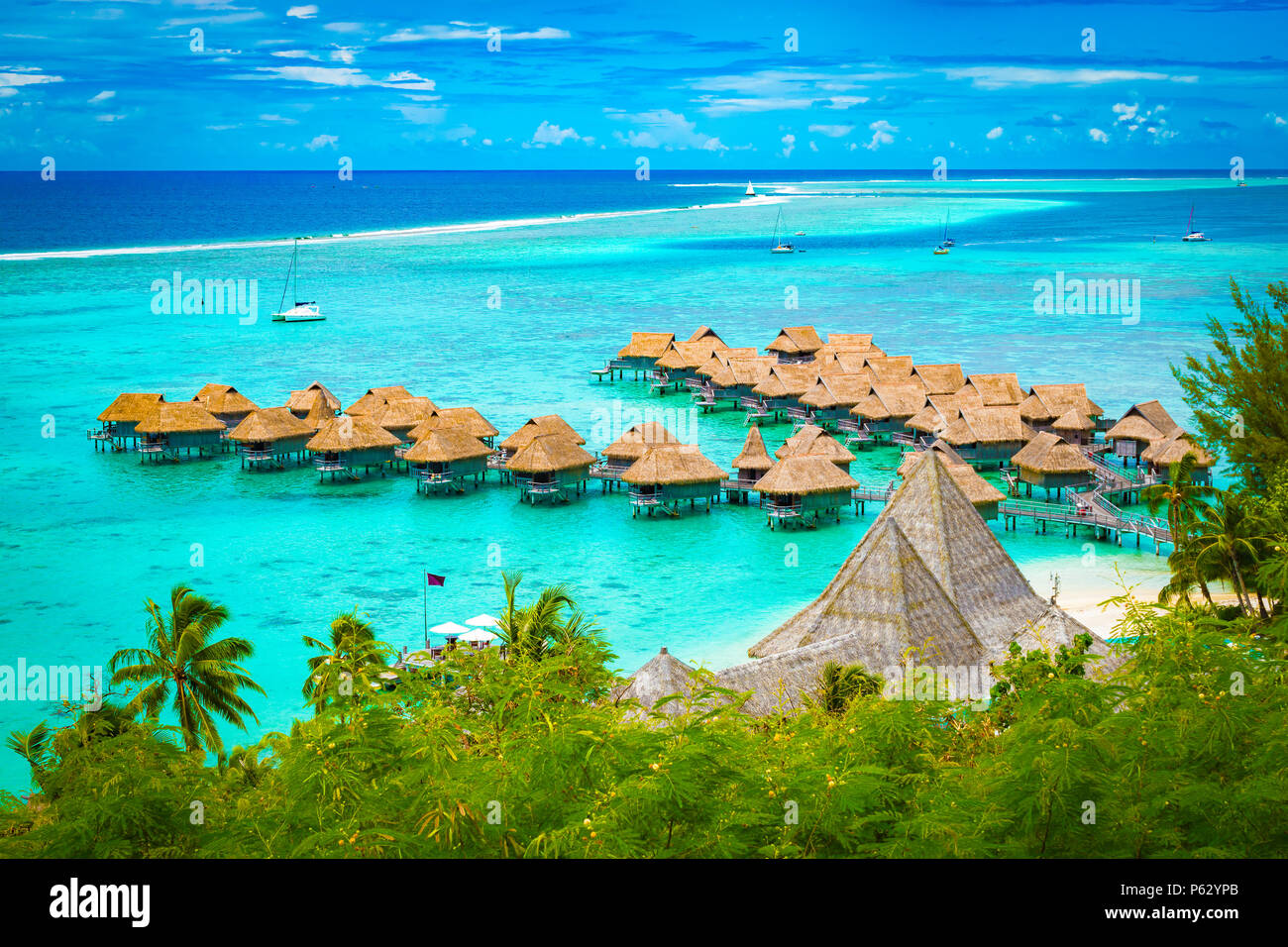 Aerial view of overwater bungalow luxury resort in turquoise lagoon water of Moorea, French Polynesia. - Stock Image