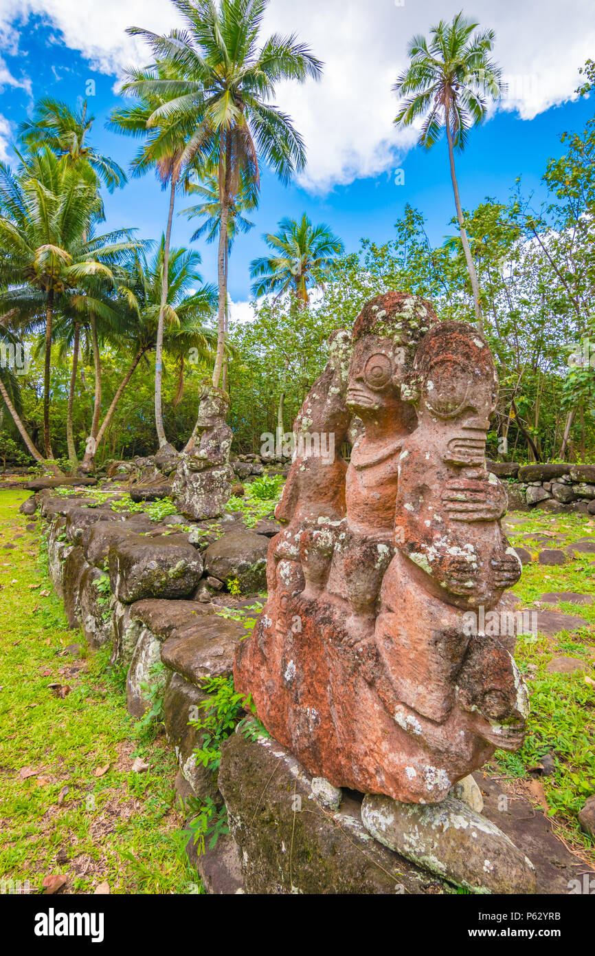Stone tiki, Nuku Hiva, Marquesas Archipelago, French Polynesia - Stock Image