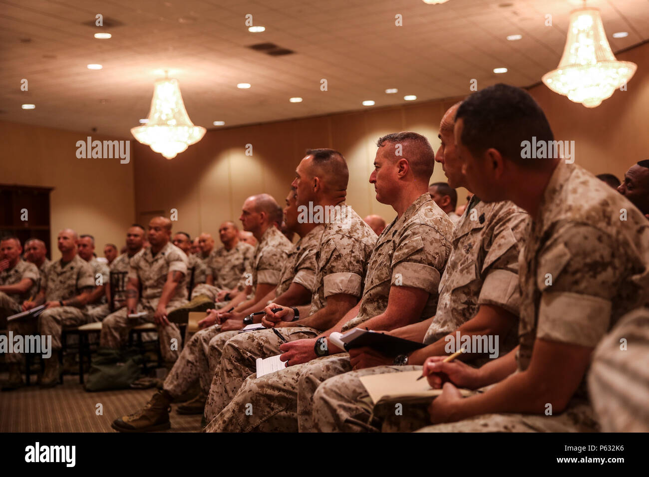 MARINE CORPS BASE CAMP PENDLETON, Calif. – Senior enlisted Marines and sailors listen to retired Gen. Peter Pace, former Chairman of the Joint Chiefs of Staff, during an E-9 symposium at Camp Pendleton April 8, 2016. Pace was the guest speaker for the event, and led participants on a guided discussion. Armed with fresh ideas, these enlightened Marines and sailors can return to their commands better prepared to lead, mentor and develop the next generation of professional warfighters. (U.S. Marine Corps photo by Sgt. Emmanuel Ramos/Released) - Stock Image