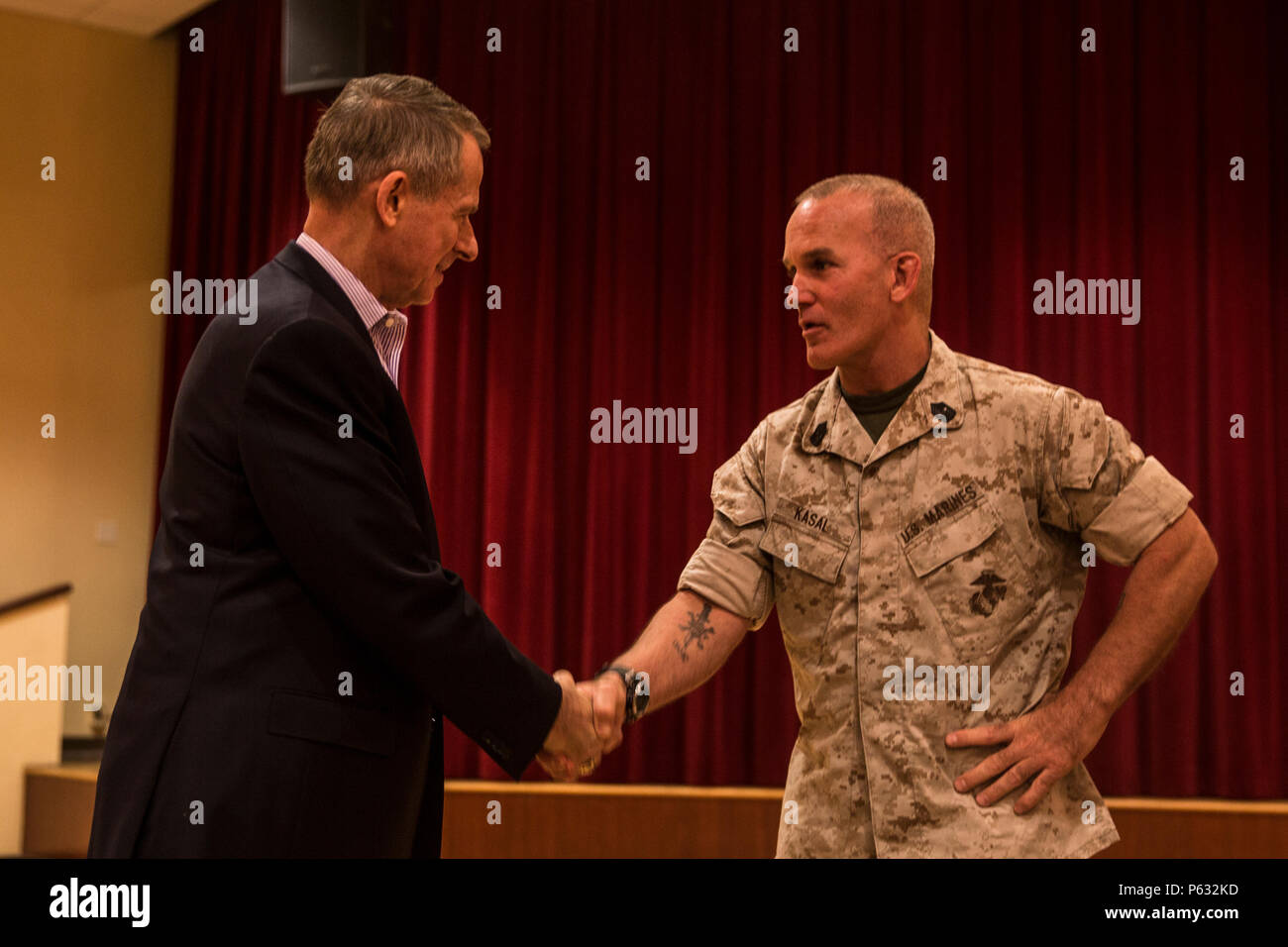 MARINE CORPS BASE CAMP PENDLETON, Calif. – Sgt. Maj. Bradley Kasal, right, sergeant major, I Marine Expeditionary Force, thanks retired Gen. Peter Pace, former Chairman of the Joint Chiefs of Staff, during an E-9 symposium at Camp Pendleton April 8, 2016. Pace was the guest speaker for the event, and led participants on a guided discussion. During his speech, Pace spoke about the strong relationship between a commander, his senior enlisted advisor, and the responsibilities senior enlisted Marines have to keep their commanders true. (U.S. Marine Corps photo by Sgt. Emmanuel Ramos/Released) - Stock Image