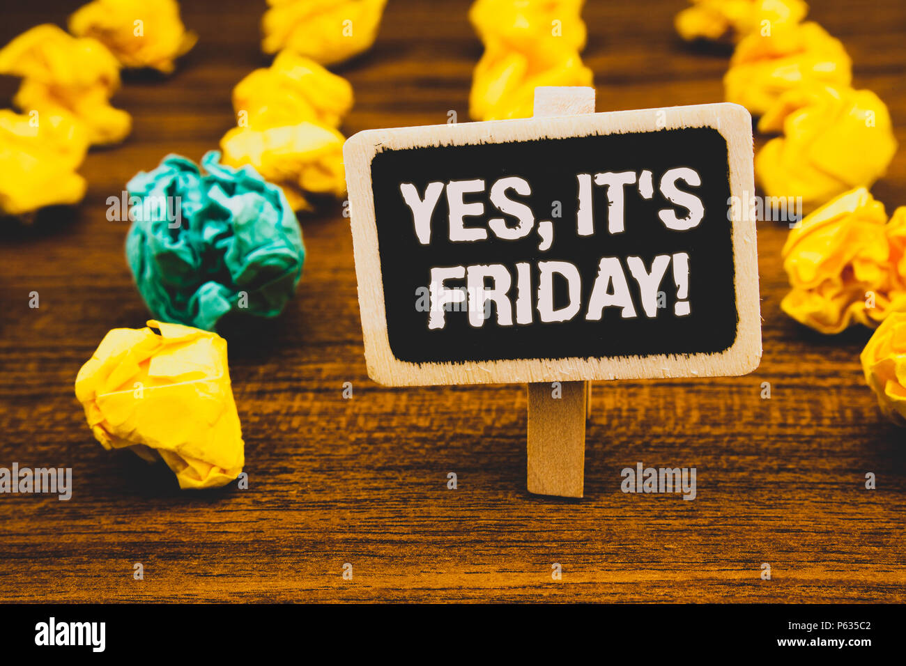 Text sign showing Yes, It'S Friday Motivational Call. Conceptual photo having weekend Taking rest break Blackboard with letters wooden floor blurry ye - Stock Image