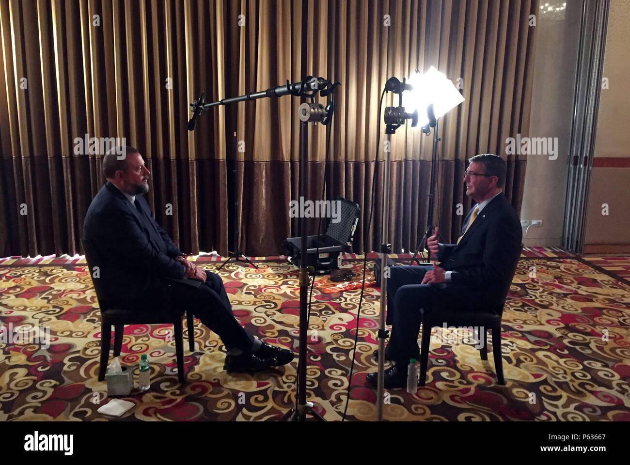Secretary of Defense Ash Carter is interviewed by Shane Smith of Vice in Manila, Philippines April 16, 2016. Carter is visiting the Philippines to solidify the rebalance to the Asia-Pacific region.(Photo by Senior Master Sgt. Adrian Cadiz)(Released) Stock Photo