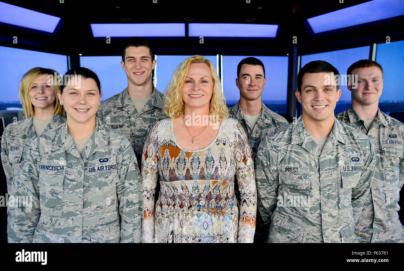 Retired Senior Master Sgt. Angela Hull, a watch supervisor at MacDill Air Force Base's air traffic control tower, stands with her team of air traffic controllers at MacDill Air Force Base, Fla., April 17, 2016. Hull continues to serve today as a civilian Airman sharing the knowledge and experience she gained from her long career. (U.S. Air Force photo by Senior Airman Ned T. Johnston) Stock Photo