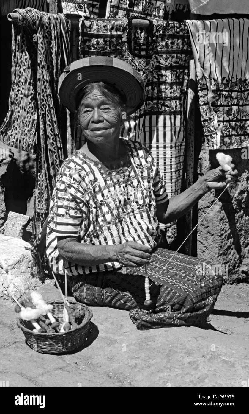 NATIVE TZUTUJIL WOMAN of SANTIAGO ATITLAN wearing traditional HUIPIL and TOCAYAL (headdress) - GUATEMALA - Stock Image