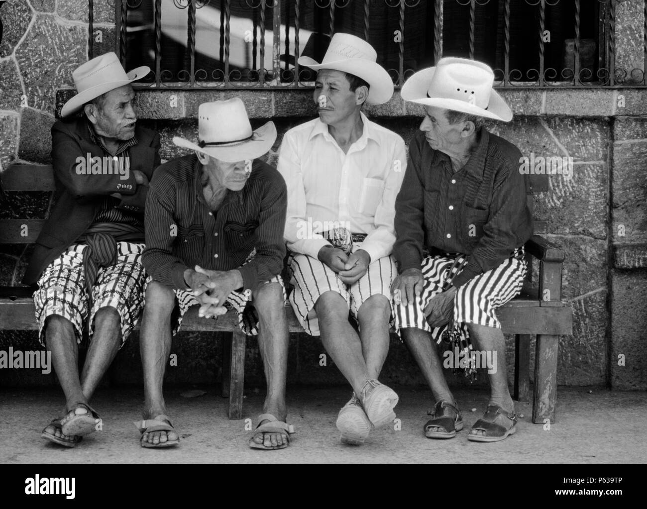 TZUTUJIL MEN in traditional dress with COWBOY HATS - SANTIAGO ATITLAN, GUATEMALA Stock Photo