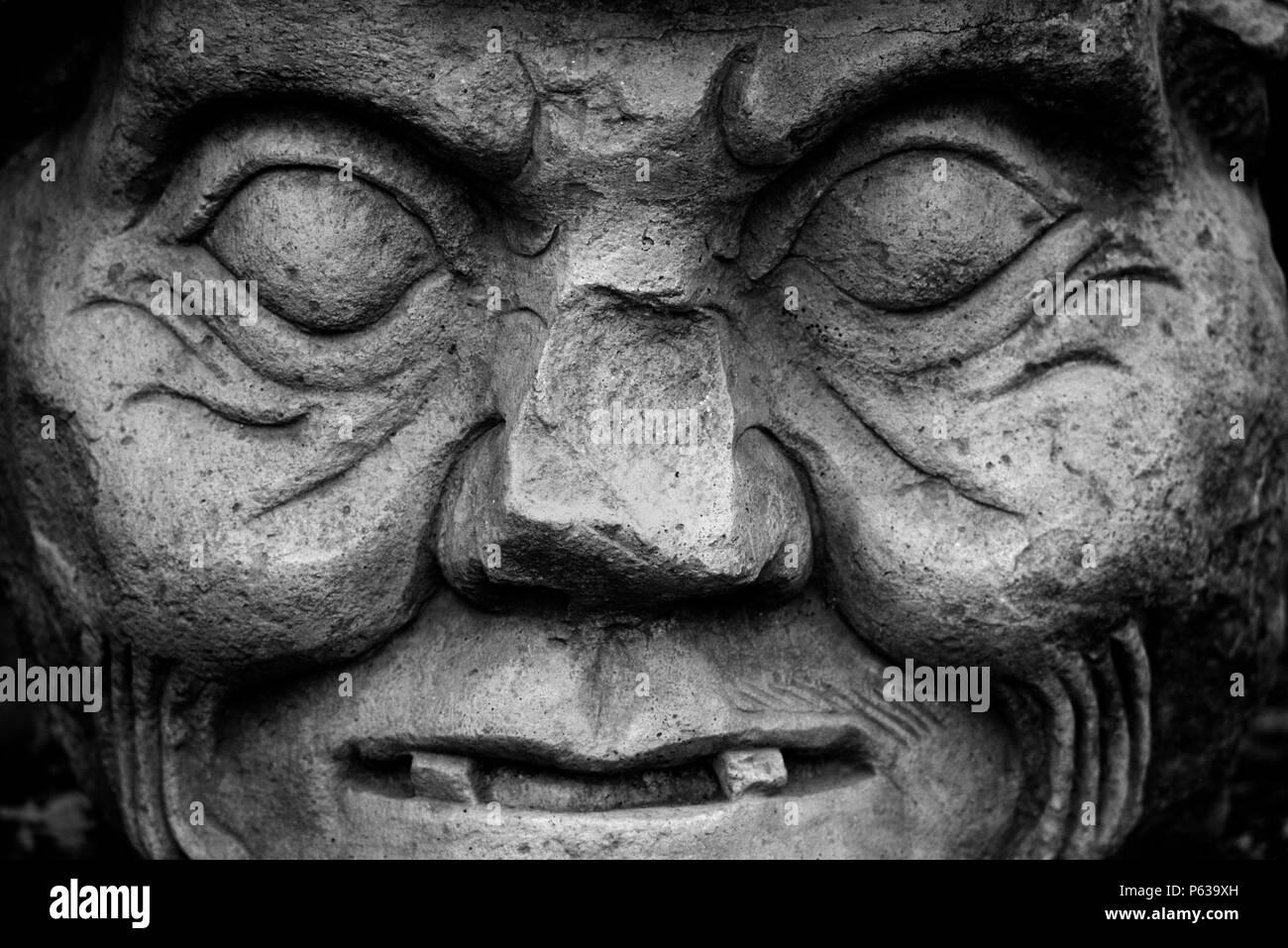 STONE SCULPTURE of MAYAN GOD of MEDECINE & SCIENCE - COPAN RUINS, HONDURAS Stock Photo