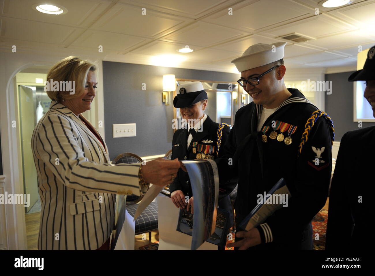 NEWPORT NEWS, Va., (April 8, 2016) Susan Ford Bales, ship sponsor, presents autographed ship photos to members of Pre-Commissioning Unit Gerald R. Ford's (CVN 78) command choir.  Ford is the first of a new class of aircraft carriers currently under construction by Huntington Ingalls Newport News Shipbuilding. (U.S. Navy photo by Mass Communication Specialist 3rd Class Matthew Fairchild/Released) - Stock Image