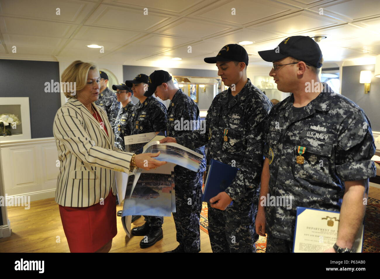 NEWPORT NEWS, Va., (April 8, 2016) Susan Ford Bales, ship sponsor, presents autographed photos of the ship to Sailors assigned to Pre-Commissioning Unit Gerald R. Ford's (CVN 78) Reactor department.  Ford is the first of a new class of aircraft carriers currently under construction by Huntington Ingalls Newport News Shipbuilding. (U.S. Navy photo by Mass Communication Specialist 3rd Class Matthew Fairchild/Released) - Stock Image