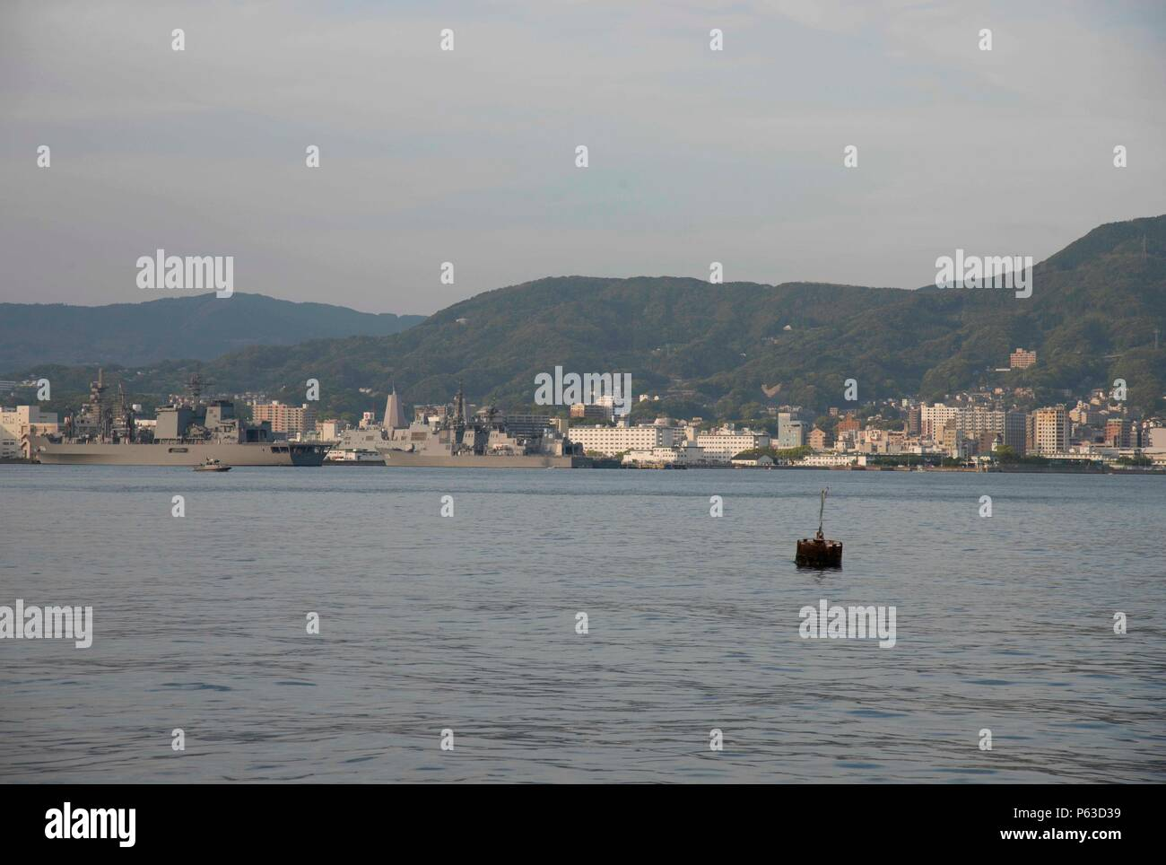 SASEBO, Japan (Apr. 18, 2016)  Commander, U.S. Fleet Activities Sasebo enables 13 forward-deployed Naval forces and 26 tenant commands across 11 geographic locations, supporting a community of 7,000 Sailors, civilians, and family members. The base has received awards for Safety, Environmental, Zumwalt Lodging, Golden Anchor, Food Service, and the 2015 Region Japan Installation of the Year. (U.S. Navy photo by Mass Communication Specialist 1st Class David R. Krigbaum/Released) Stock Photo