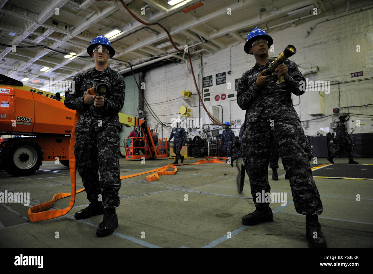 NEWPORT NEWS, Va. (Apr 19, 2016) -- Sailors assigned to Pre-Commissioning Unit Gerald R. Ford (CVN 78) perform firefighting drills in the ship's hangar bay. Ford is the first of a new class of aircraft carriers currently under construction by Huntington Ingalls Industries Newport News Shipbuilding. (U.S. Navy photo by Mass Communication Specialist Seaman Apprentice Connor Loessin/Released) - Stock Image
