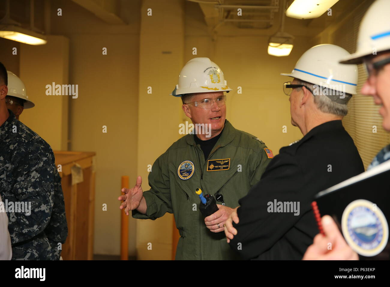 NEWPORT NEWS, Va. (Apr 20, 2016) -- Commanding Officer of Pre-Commissioning Unit Gerald R. Ford (CVN 78) Capt. Richard McCormick talks to Rear Adm. Thomas Moore during a tour of the ship. Ford is the first of a new class of aircraft carriers currently under construction by Huntington Ingalls Industries Newport News Shipbuilding. (U.S. Navy photo by Mass Communication Specialist Seaman Apprentice Connor Loessin/Released) - Stock Image