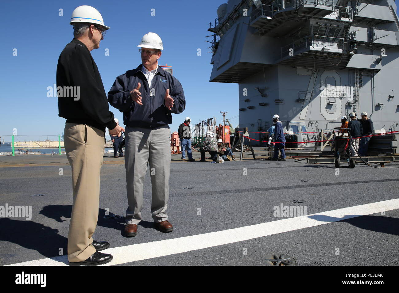 NEWPORT NEWS, Va. (Apr 20, 2016) -- Rear Adm. Thomas Moore takes a tour of Pre-Commissioning Unit Gerald R. Ford (CVN 78) with super intendants of Huntington Ingalls Industries Newport News Shipbuilding (HIINNS). Ford is the first of a new class of aircraft carriers currently under construction by HIINNS. (U.S. Navy photo by Mass Communication Specialist Seaman Apprentice Connor Loessin/Released) - Stock Image