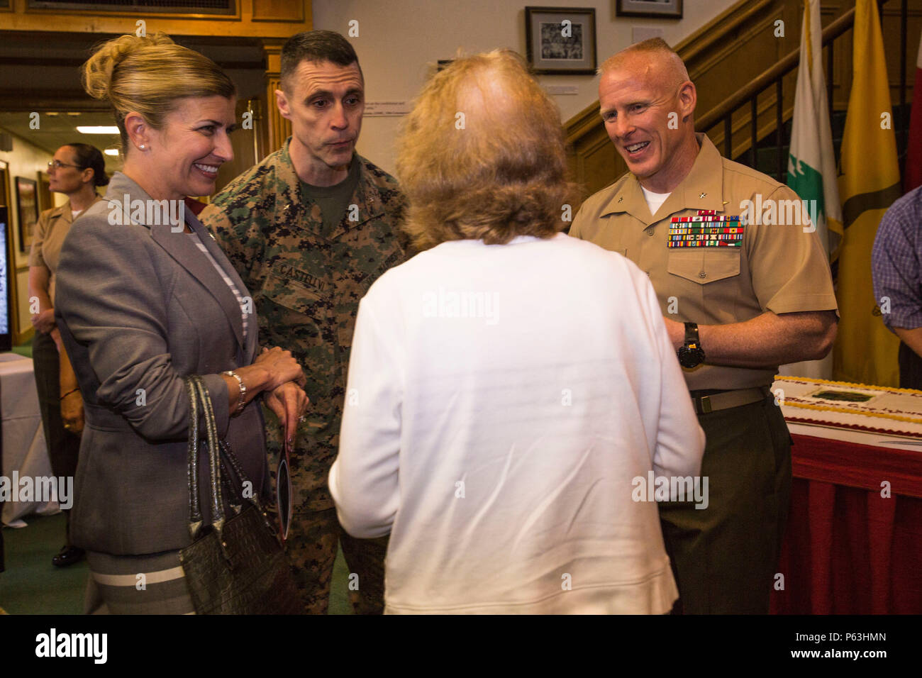 U.S. Marine Corps Brig. Gen. Robert F. Castellvi, center left, commanding general of 2nd Marine Expeditionary Brigade, and Brig. Gen. Thomas D. Weidley, commanding general of Marine Corps Installations East, right, and his wife Mrs. Weidley, left, speak to guests attending Marine Corps Base Camp Lejeune's 75th Anniversary ceremony, N.C., April 29, 2016. Camp Lejeune was established in 1941 and is now home to more than 36,000 military personnel. (U.S. Marine Corps photo by Lance Cpl. Judith L. Harter, MCIEAST Combat Camera/Released) - Stock Image