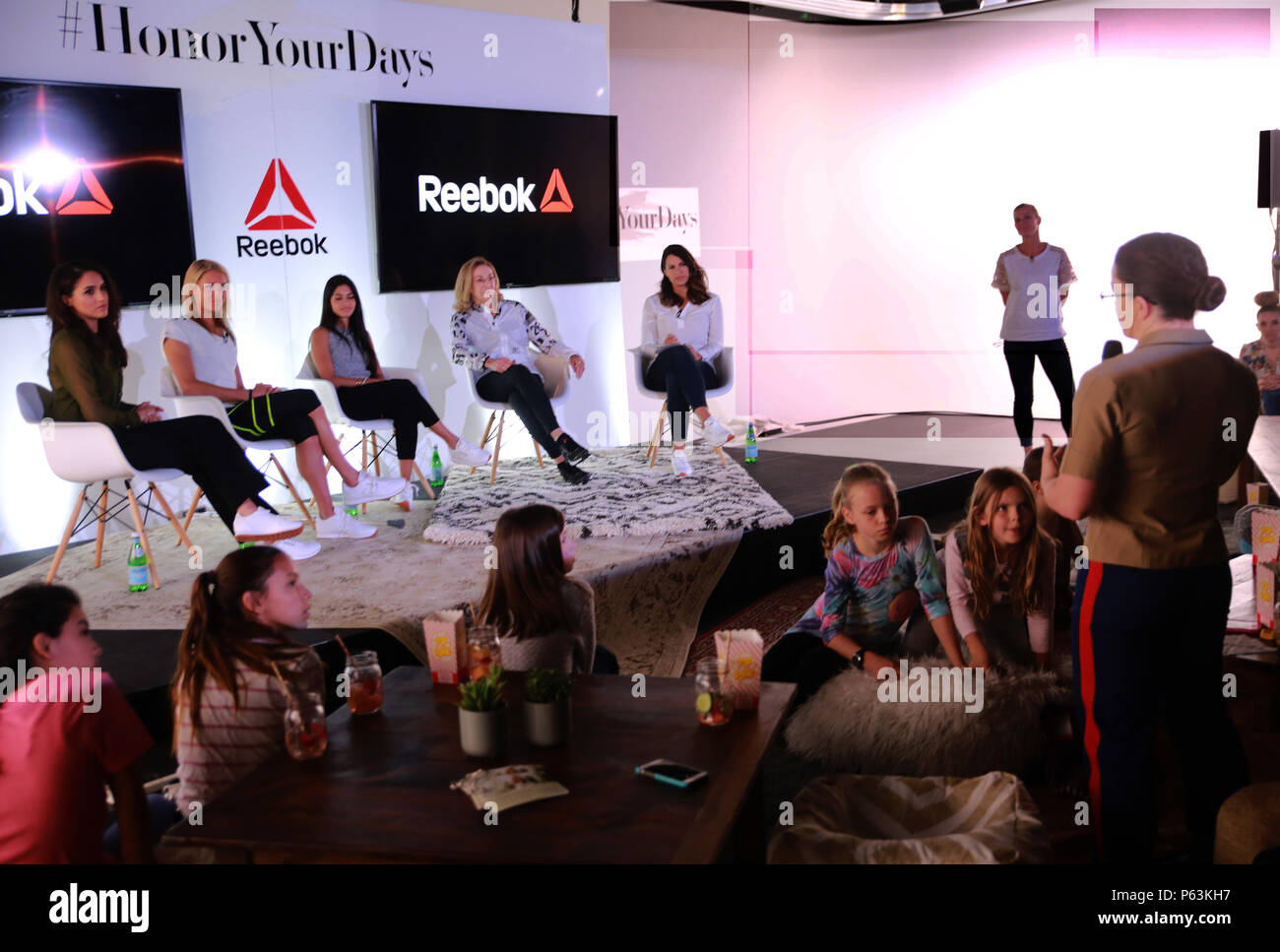 Major Misty Posey speaks to a panel of women at the Reebok