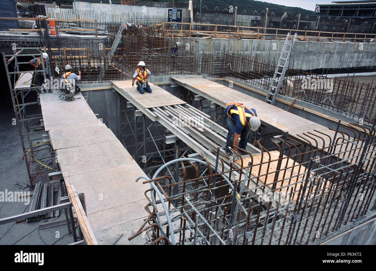 Fixing formwork for concreting Calgary Wastwater treatment plant, Alberta, Canada Stock Photo