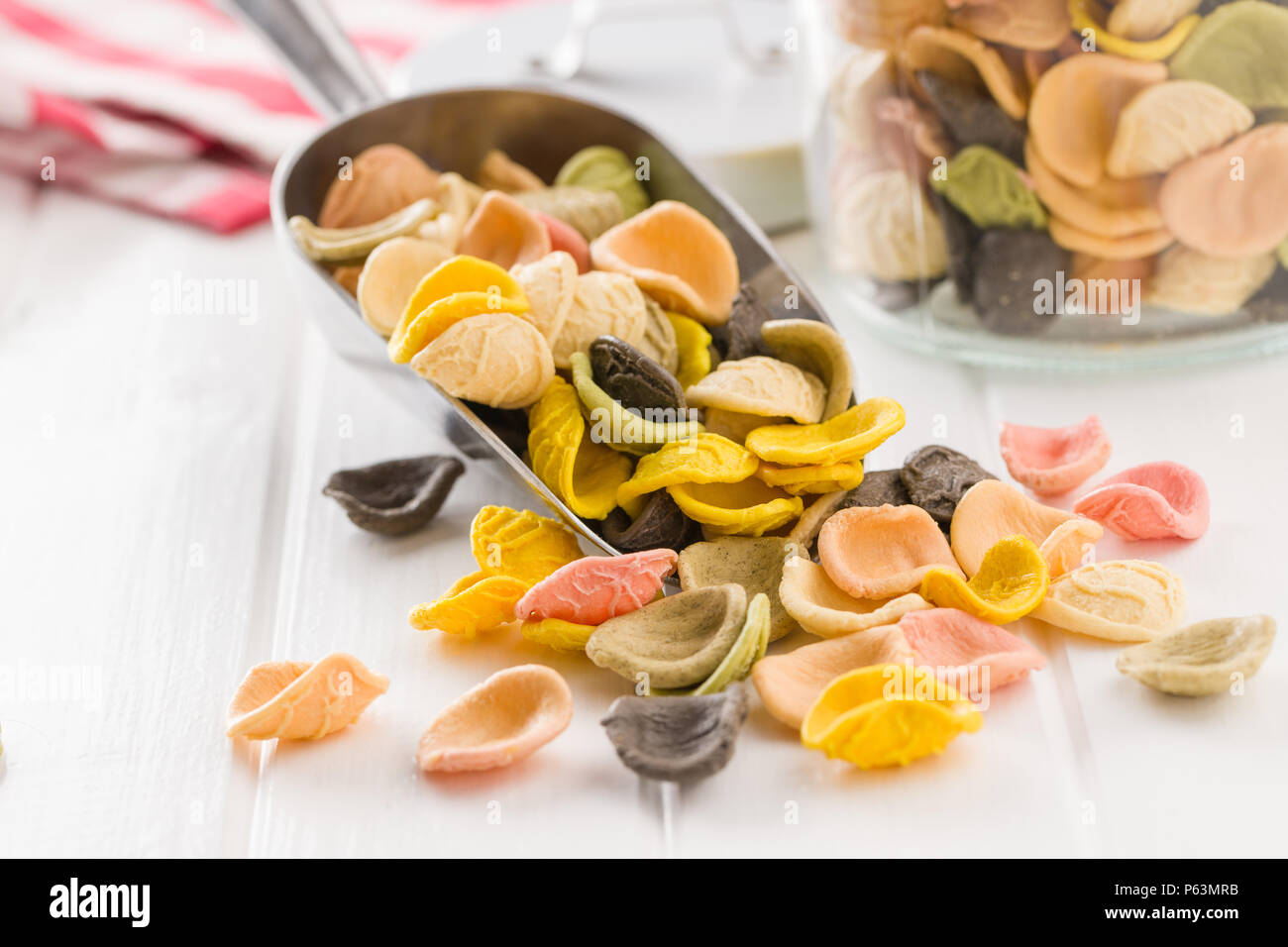 Italian rainbow pasta in scoop. - Stock Image