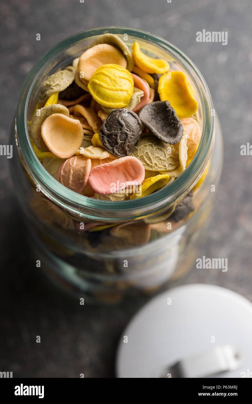 Italian rainbow pasta in jar. - Stock Image