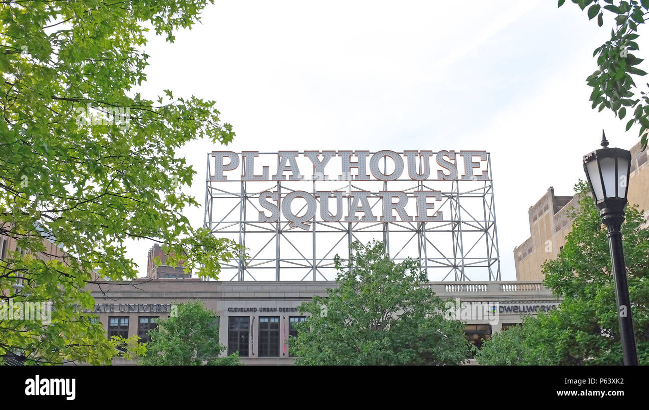 The retro Playhouse Square sign towers over Euclid Avenue in downtown Cleveland with its 9-foot letters lit at night in this bustling theater district - Stock Image