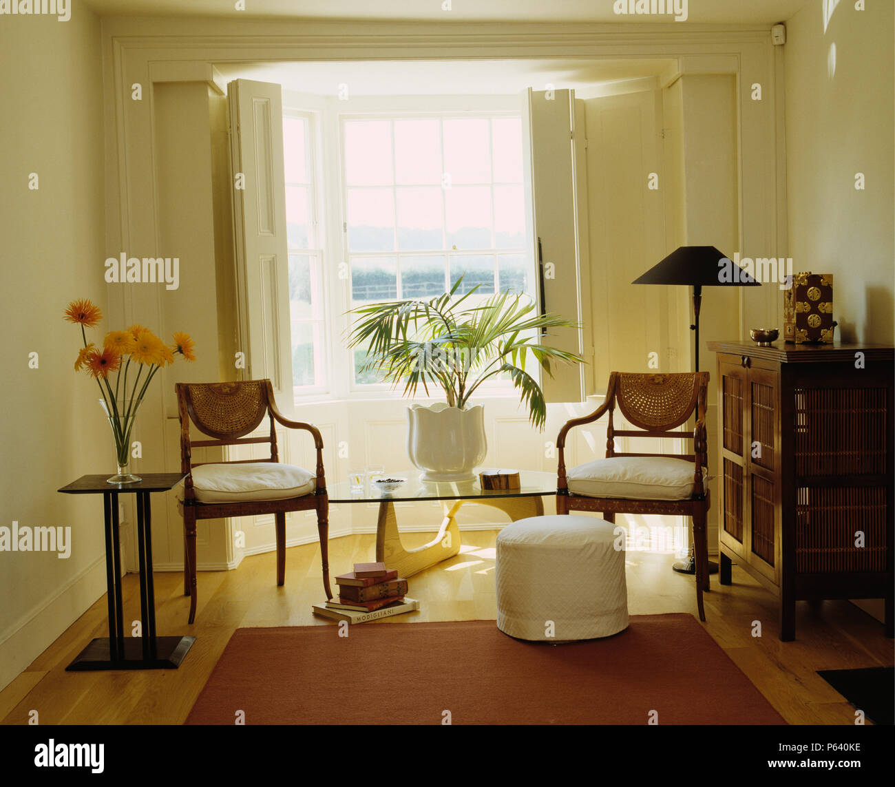 Antique Chairs And Cabinet In Modern Sitting Room With A