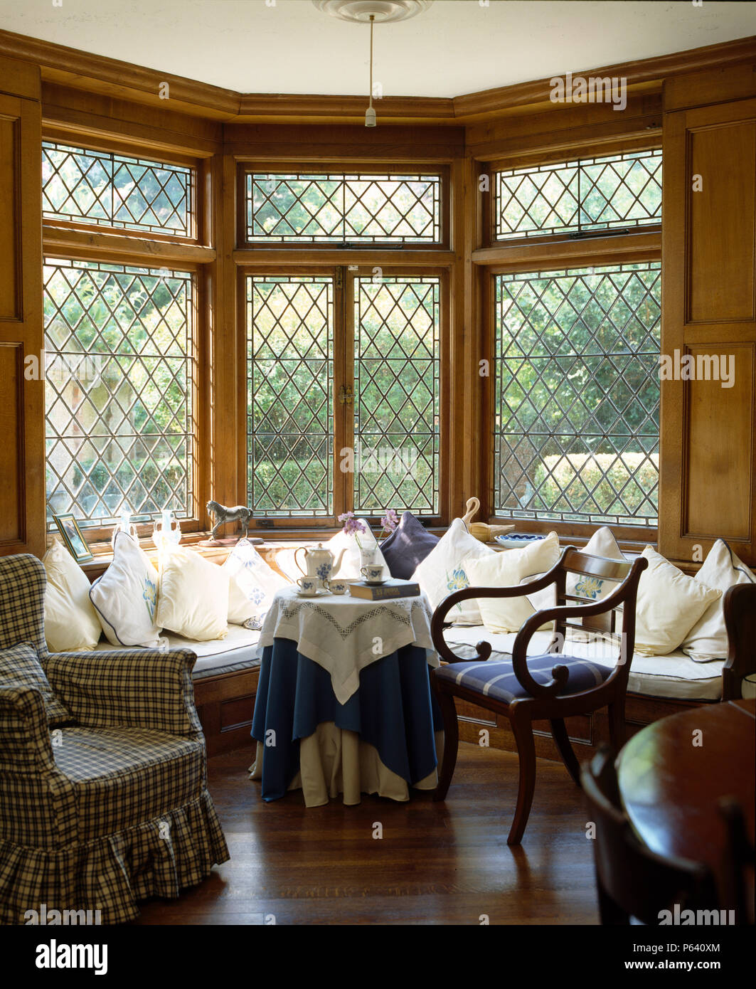 White Cushions On Window Seat Below Lattice Bay Window In Country