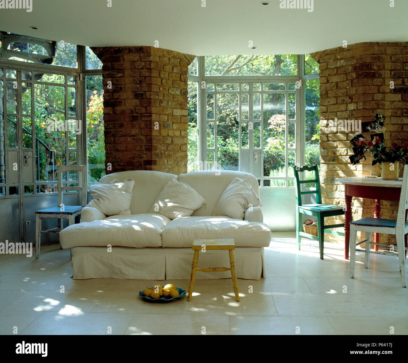 White Sofa In Light And Airy White Living Room Extension With Exposed Brick  Pillars   Stock