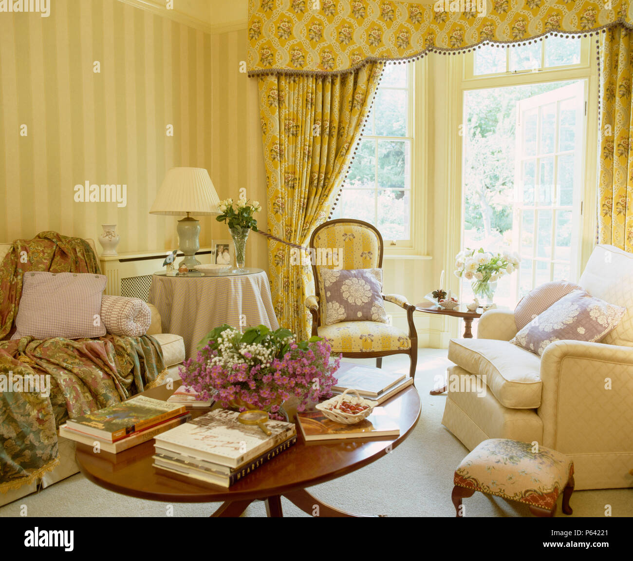 Pierre Frey curtains on French windows in country living room with ...