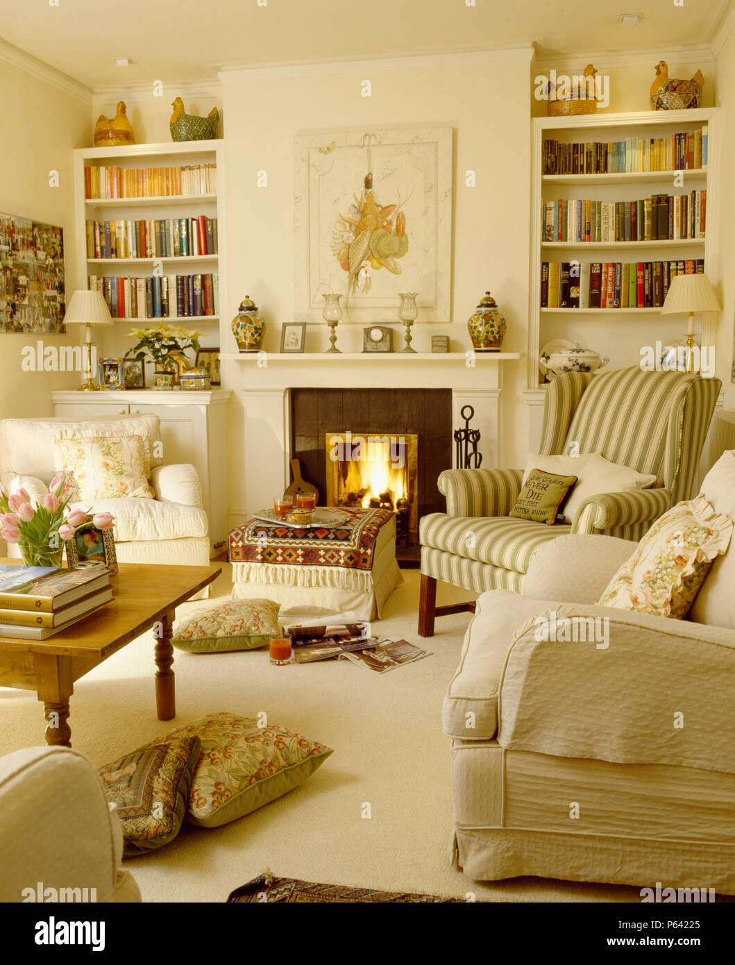 Groovy Fitted Bookshelves On Either Side Of Fireplace With Lighted Home Interior And Landscaping Mentranervesignezvosmurscom