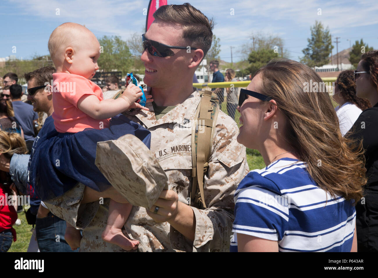 Cpl. John Sherriffs, rifleman, 1st Battalion, 7th Marine Regiment, greets his 7-month-old daughter, April, during the battalion's homecoming at Del Valle Field April 23, 2016. 1/7 was deployed as part of Special Purpose Marine Air Ground Task Force-Crisis Response-Central Command 16.1. (Official Marine Corps photo by Cpl. Medina Ayala-Lo/Released) Stock Photo