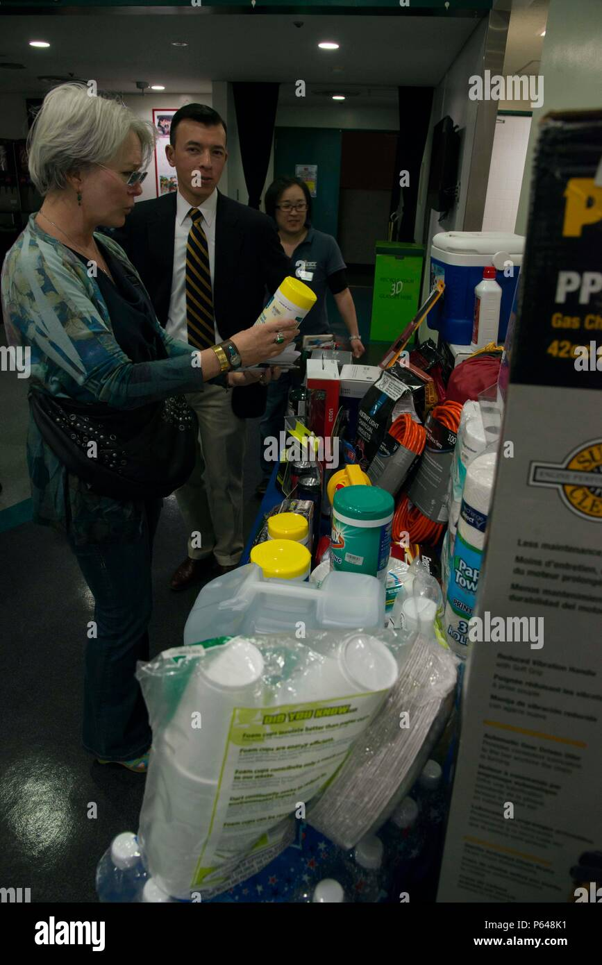 SASEBO, Japan (Apr. 19, 2016) Members of the Commander, U.S. Fleet Activities Sasebo community look at recommended home disaster kit items as part of a CFAS typhoon readiness stand down held Apr. 19, 2016. (U.S. Navy photo by Mass Communication Specialist 1st Class David R. Krigbaum/Released) Stock Photo