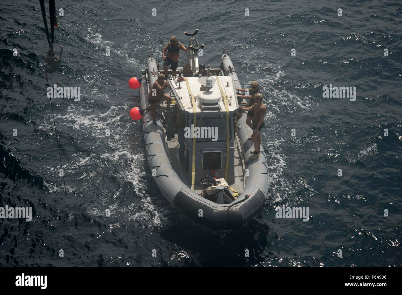 U S  Navy Sailors, attached to Commander, Task Group 56 1, return