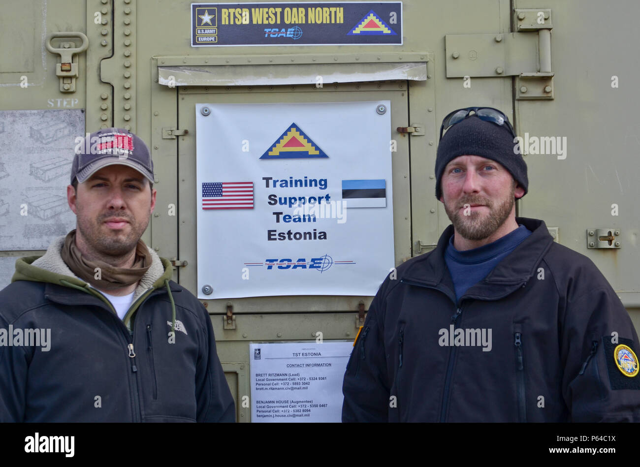 The U.S. Training Support Team in Estonia, Brett Ritzmann (right) and Benjamin House (left), make themselves available to answer questions during an open house at Tapa Military Base, Estonia, April 25, 2016. (U.S. Army Photo by Staff Sgt. Steven M. Colvin) - Stock Image