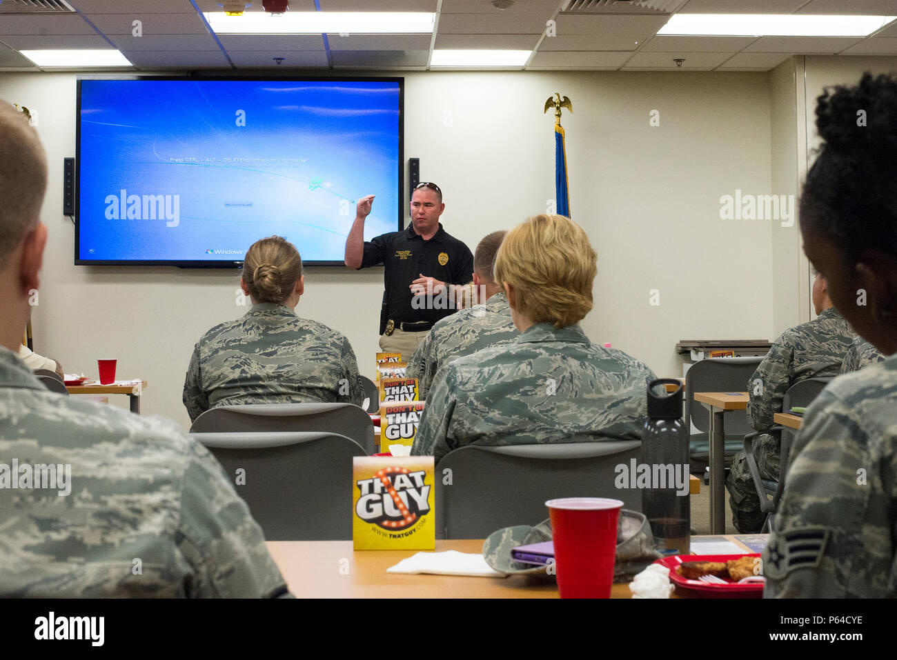 Valdosta Police Department patrolman, Alvin May, briefs Airmen on the dangers of drinking and driving during a lunch and learn, April 8, 2016, at Moody Air Force Base, Ga. Moody invited the VPD to speak to Airmen in observation of Alcohol Awareness Month. (U.S. Air Force photo by Airman Daniel Snider/Released) - Stock Image