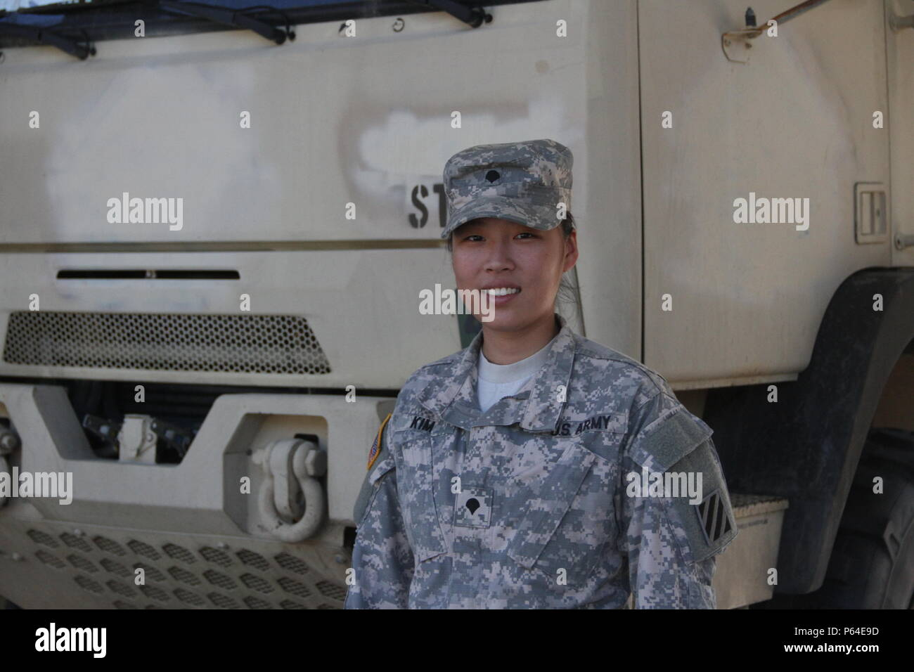"""Spc. Angela Kim, a health care specialist and unit armorer with, Headquarter and Headquarter Company, 9th Brigade Engineer Battalion, 2nd Infantry Brigade Combat Team, 3rd Infantry Division. """"If I could tell my younger self something, it would be not to take too long planning and being afraid of something new, because I have really found something that is right for me."""" - Stock Image"""