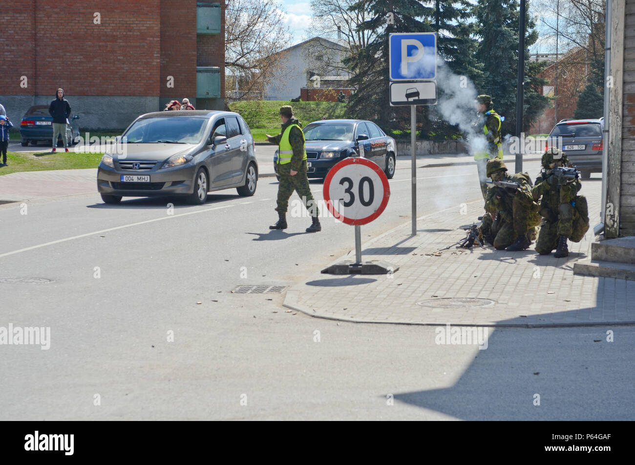 Estonian Soldiers of 2nd Infantry Brigade, Kuperjanov Battalion, suppress enemy fire in the center of town as Estonian civilians watch during an urban operations exercise, Voru, Estonia, April 30,2016. (Photo by U.S. Army Staff Sgt. Steven M. Colvin/Released) Stock Photo