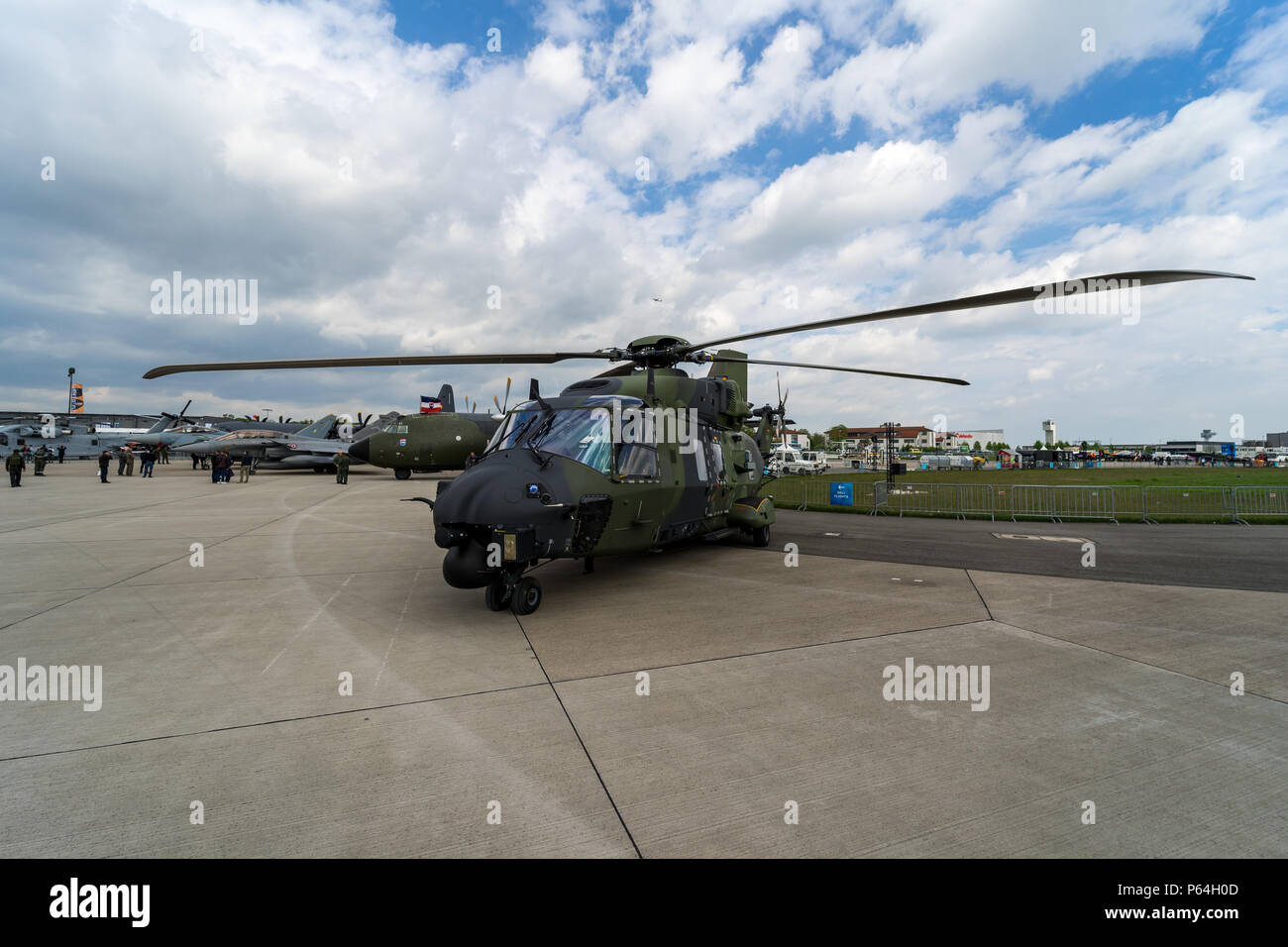 BERLIN, GERMANY - APRIL 25, 2018: Medium utility military helicopter NHIndustries NH90. German Army. Exhibition ILA Berlin Air Show 2018. - Stock Image