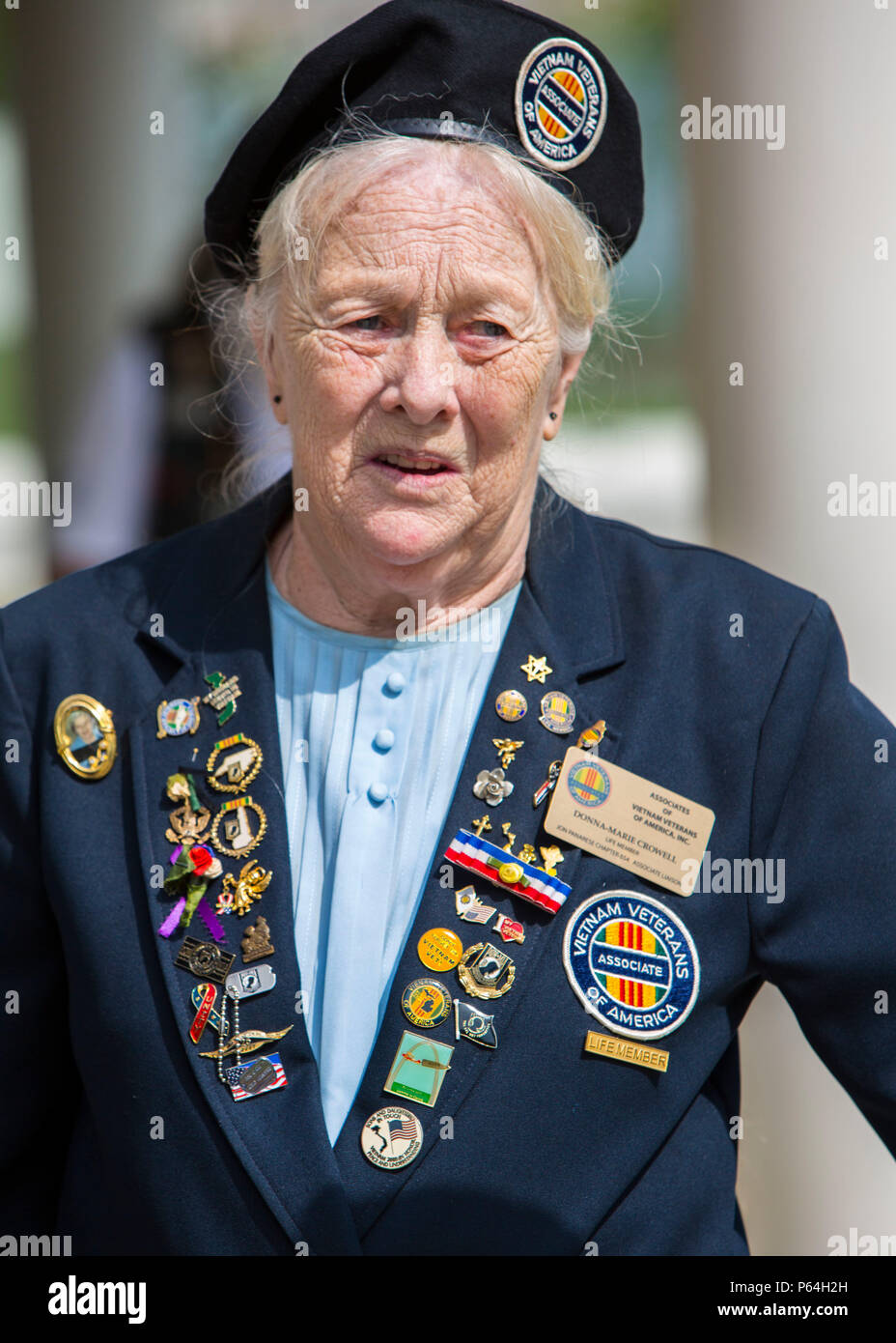 Donna-Marie Crowell, life member of the Vietnam Veterans of America Incorporated, Chapter 654, socializes with guests during the Vietnam War ceremony at the Lejeune Memorial Gardens in Jacksonville, N.C., April 30, 2016. The ceremony honors all those who sacrificed while celebrating the accomplishments and perseverance of all Vietnam-era veterans. (U.S. Marine Corps photo by Lance Cpl. Austin M. Livingston, MCIEAST Combat Camera/Released) - Stock Image