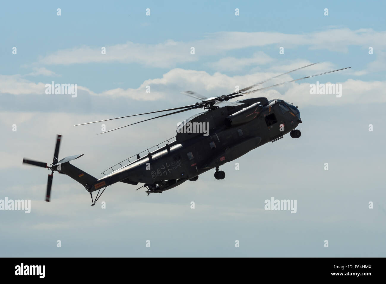 Demonstration flight of the medium utility military helicopter NHIndustries NH90. German Army. Exhibition ILA Berlin Air Show 2018. - Stock Image